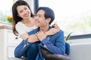 Young Asian couple chatting happily photo
