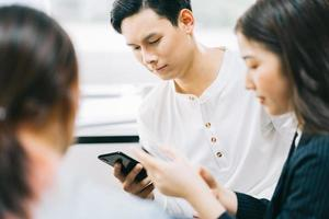 Young Asians are using their phones to connect with each other through social networking platforms photo