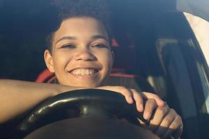 Beautiful African American woman with short hair in the car, lifestyle photo