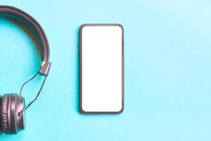 Headphones and smartphone on colorful background. photo
