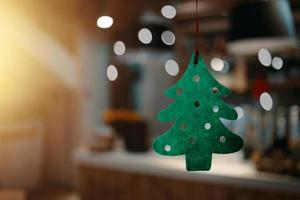 Christmas green felt tree with carved circles. photo