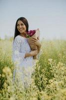 Young woman in the rapeseed field photo