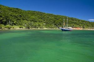 Boat in the tropical water of brazil photo