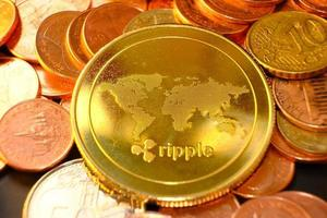 cryptocurrency coins on table and digital currency money concept, crypto market, cryptocurrency financial systems concept, Gold coins background photo