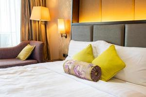 Comfortable pillow decoration on bed in hotel bedroom photo
