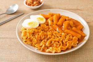 Rabokki, or Ramen or Korean instant noodle and Tteokbokki in spicy Korean sauce - Korean food style photo