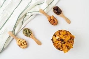 Grains cornflakes of cashew nut, almond, pumpkin seeds and sunflower seeds - healthy multigrain food photo