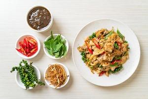 Stir-fried holy basil with fish and herb - Asian food style photo