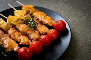 Grilled chicken barbecue skewer on plate photo