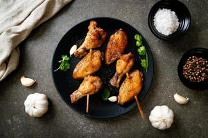 Grilled chicken wings barbecue with pepper and garlic photo