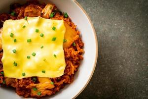 Kimchi fried rice with pork and topped cheese - Asian and fusion food style photo