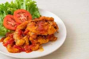 Fried fish topped with 3 flavors, sweet, sour, and spicy chili sauce photo