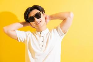 Asian man on a yellow background photo