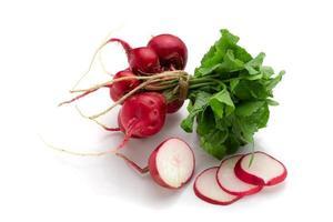 Freshly ripe radishes isolated on white background photo