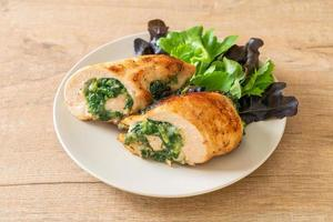 Chicken breast stuffed with cheese and spinach photo