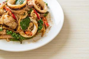 Stir-fried holy basil with octopus or squid and herb - Asian food style photo