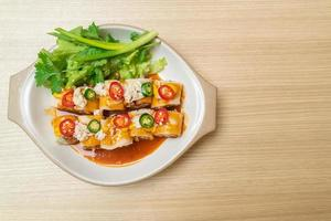 Fresh spring rolls with crab and sauce and vegetables - healthy food style photo