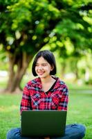 Asian women smile happily and laptop. Work online online communication Messaging Online learning Online communication concept photo