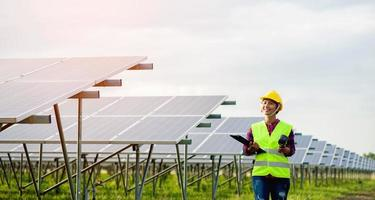 A young female solar cell engineer is working hard. Working in alternative energy Solar energy photo