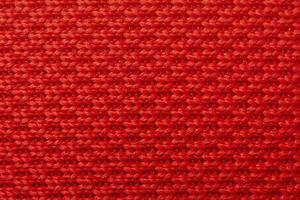 Fondo de tela con tejido en rojo. material para diseñadores. textura de tela roja. foto