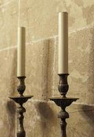 Old medieval candelabrum with wax candles photo