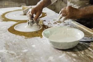 Craftsman working and molding plaster photo
