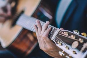Close up hand playing guitar photo