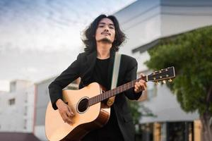 Portraits man hold guitar playing music festival outdoor, lifestyle fashion music street outdoor photo