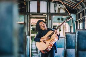 Man playing guitar rock so excited music entertainment , man play guitar on train photo