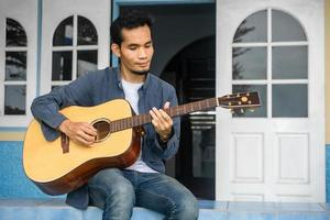 Man playing guitar happy leisure at home photo