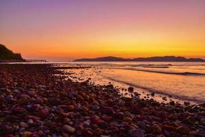 Landscape beach view sunrise on evening background at Sattahip Chon Buri Thailand photo