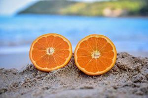 Orange is on beach sea view background,Summer holiday concept photo