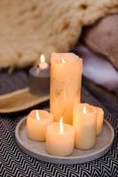 Burning candles on table indoors. Interior decor element photo