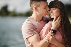Loving young couple kissing and hugging in outdoors. Love and tenderness, dating, romance, family, anniversary concept. photo