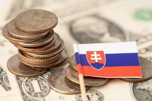 Stack of coins with Slovakia flag on US dollar banknotes background. photo