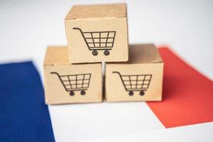 Box with shopping cart logo and France flag, Import Export Shopping online or eCommerce finance delivery service store product shipping, trade, supplier concept. photo