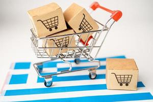Box with shopping cart logo and Greece flag, Import Export Shopping online or eCommerce finance delivery service store product shipping, trade, supplier concept. photo