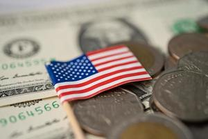 Stack of coins with USA America flag on USA America dollar banknotes. photo