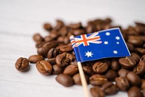 Bandera de Australia en granos de café, concepto de comida de bebida de exportación de importación. foto