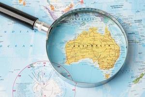 Bangkok, Thailand - November 01, 2020 Australia, Magnifying glass close up with colorful world map photo