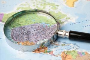 Bangkok, Thailand - November 01, 2020 USA, America, Magnifying glass close up with colorful world map photo