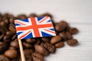 United Kingdom flag on coffee beans. Import-export drink food concept. photo