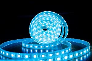 babin of glowing decorative LED strip of blue cold color on a black background photo