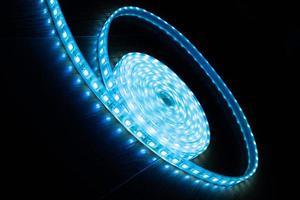 a skein of blue LED strip on a black background photo
