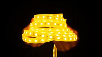 a roll of shining LED strip in dark photo