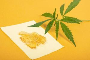 pieces of yellow cannabis wax, marijuana concentrate high in THC photo