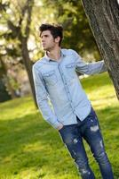 Attractive young handsome man, model of fashion photo