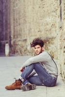 Man wearing suspenders in urban background photo