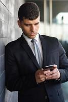 Young businessman on the phone in an office building photo