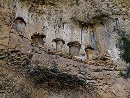 Very old beehives hanging on the mountain, province of Soria, CAstilla y Leon, Spain photo